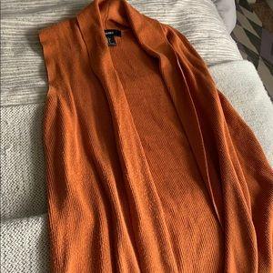 Long orange sweater